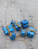 Little blue gifts on wood board. Little gifts on wood board Royalty Free Stock Photography