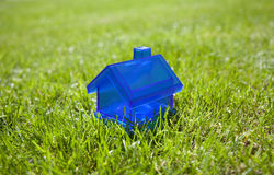 Little blue house on grass Royalty Free Stock Photo