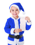 Little blue Santa Claus boy showing wish list Stock Photo