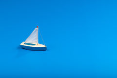 Little blue toy boat Stock Photography
