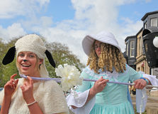 Little Bo Peep finds her Sheep. Fun capture with Guy dressed as Bo Peep hooking one of his flock at a Fancy Dress Charity Wheelbarrow race at Corbridge Stock Images