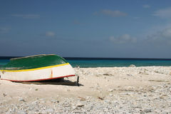 Little boat on the beach. Little fishing boat on the beach, with blue sky and blue ocean royalty free stock photos