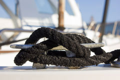 Little boat bollard with black marine cord node Royalty Free Stock Images