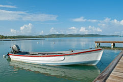 Little boat on the dock. Little fisherman boat by the dock Stock Images