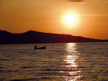Little boat in golden sunset. On Adriatic sea Royalty Free Stock Photo