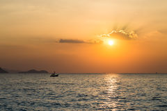 Little boat in the sea. Sunset in Thailand Royalty Free Stock Photos