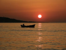 Little boat in summer sunset Royalty Free Stock Photography