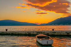 Little boat in the summer sunset in Montenegro. Little boat in the summer sunset Stock Photography