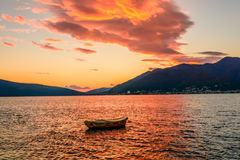 Little boat in the summer sunset in Montenegro. Little boat in the summer sunset royalty free stock images