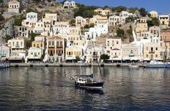 Little boat in a Symi bay. Mediterranean sea. Greece Royalty Free Stock Image