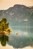 Little boat on water, norway fjord Stock Photo