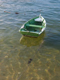 Little boat in the water. Little boat in the sea water stock image