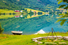 Little boat on water shore, norway fjord Stock Photo