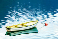 Little boat on water surface Stock Photos