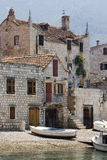 Little boats in front of houses in Komiza on Vis island Royalty Free Stock Photography