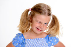 Little bold girl with pigtails. Portrait of a little bold girl with pigtails royalty free stock image