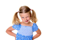 Little bold pertly with pigtails. Portrait of a little pertly girl with pigtails royalty free stock photo