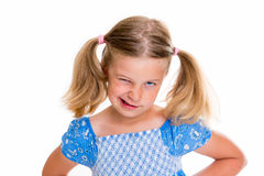 Little bold pertly with pigtails. Portrait of a little pertly girl with pigtails stock photo