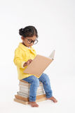 Little Bookworm Wrapped up in Reading Royalty Free Stock Images