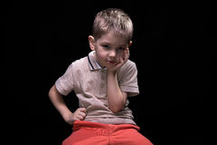 Little bored boy with hands on hips Stock Photos