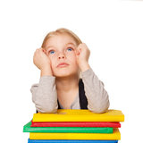 Little bored student girl with books. Royalty Free Stock Images