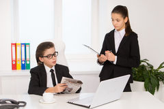 Little boss and secretary. Royalty Free Stock Photography