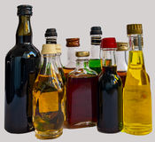Little bottles of alcohol beverages with glass Royalty Free Stock Images