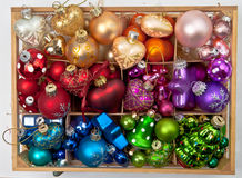 Little box with christmas baubles Stock Images