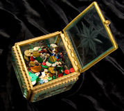 Little box with color beads on black velvet Stock Image