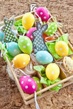 Little box full of easter decorations Stock Images