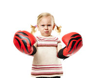 Little boxer. Little girl with huge red boxing gloves isolated on white background Stock Photography