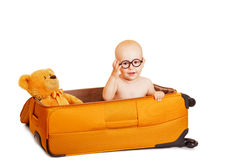 The little boy сидиит in a suitcase it's isolated on white Royalty Free Stock Image