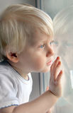 Little boy. Looking out the window Stock Photography