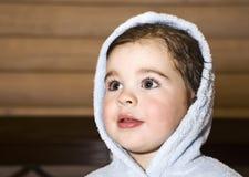 Little boy. After bath dressed in blue bathrobe Royalty Free Stock Photos