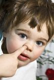 Little boy. Cute little boy picking his nose Royalty Free Stock Images