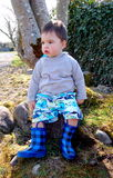 Little boy!. A cute little boy sitting under a tree stock images