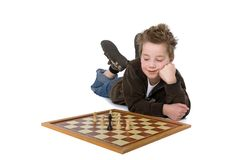 Little boy. Palying chess on the ground Royalty Free Stock Images