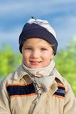Little boy. Cheerful outdoor portrait of a smailing little boy (2,5 years old Royalty Free Stock Image