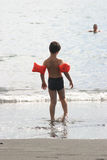 Little boy. Entering the water on a hot autumn day on La Palma, canaries stock photography