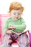 Little boy. With a book sitting on chair Royalty Free Stock Images