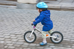 The little boy. On a bicycle in movement Royalty Free Stock Photo