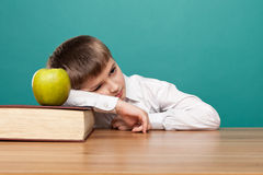 Little boy. Cheerful  little boy sitting at the table. School concept Stock Photography