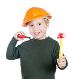A little boy. In a helmet with toy tools on white background Royalty Free Stock Photography