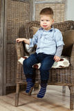 Little boy. Sits in a armchair Royalty Free Stock Photos