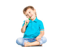 Little boy. Holding a pencil in hand on a white background Stock Image
