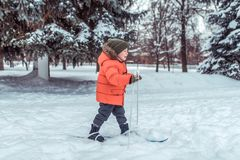 Free Little Boy 3-5 Years Old, In Winter On Children`s Rides Snow Of Snowdrifts Of Green Forest And Christmas Trees. Happy Royalty Free Stock Photos - 158163878