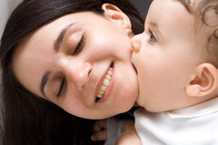 The little boy of 7 months kisses pleased mum Royalty Free Stock Image