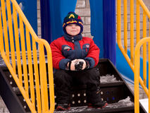 Little boy. The little boy in the street in the winter Royalty Free Stock Photo