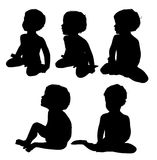 Little boy. Two years old, siting, silhouette (5 poses Stock Photos
