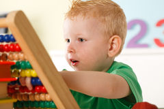 Little boy with abacus Stock Photo